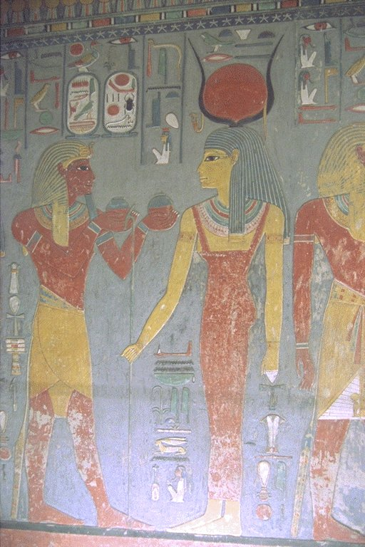 The pharaoh Horemheb with the Goddess Isis from his tomb.
